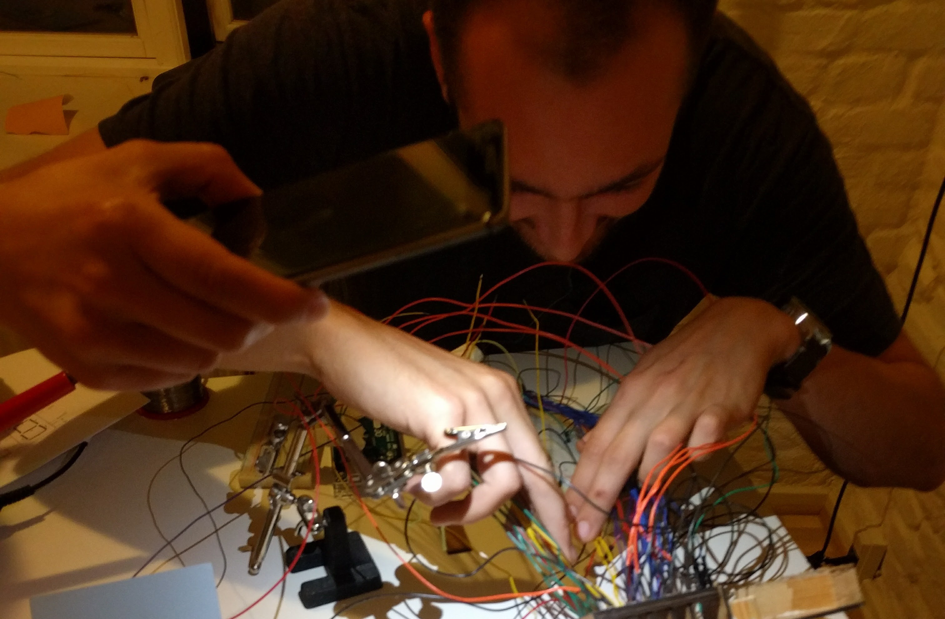 me attempting to squeeze the soldering iron between many wires